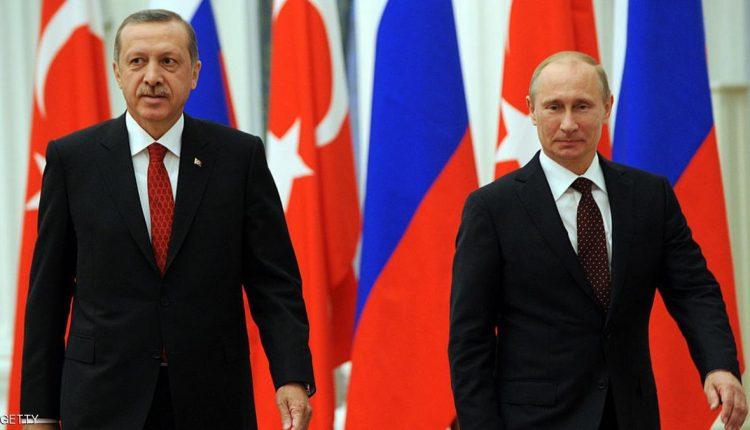 Russian President Vladimir Putin (R) and